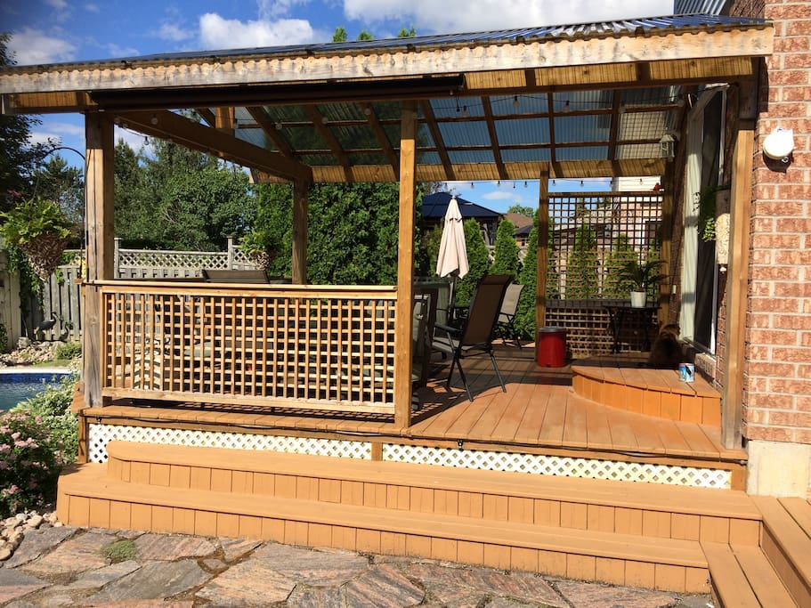 Relax under a large covered deck rain or sunshine.