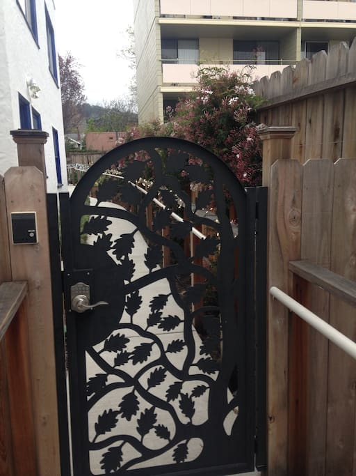 Beautiful gate and walkway to private entrance.