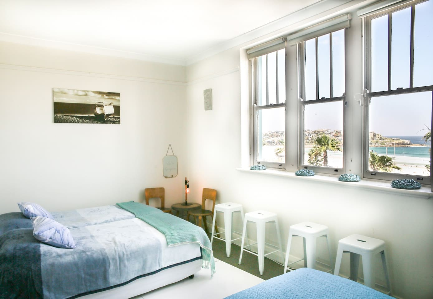 Ocean View Bed room with queen size bed and 2  king single beds.