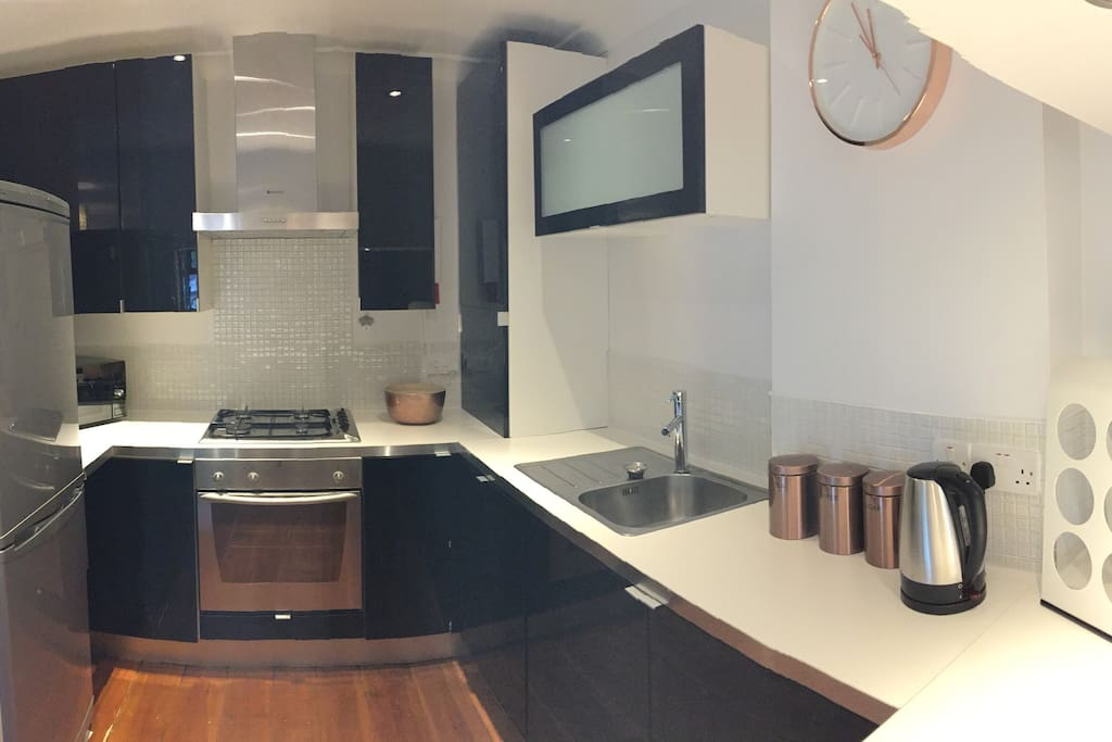 Uncluttered kitchen with all essentials provided including tea & coffee - just bring your own milk.