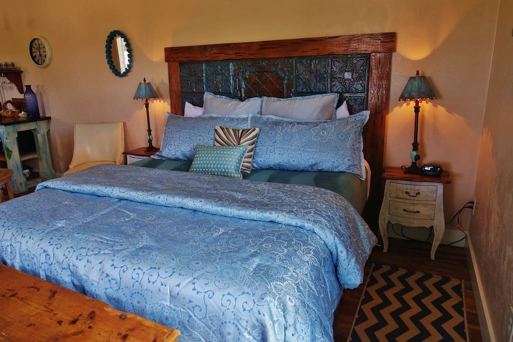 California King Bed with luxurious linens