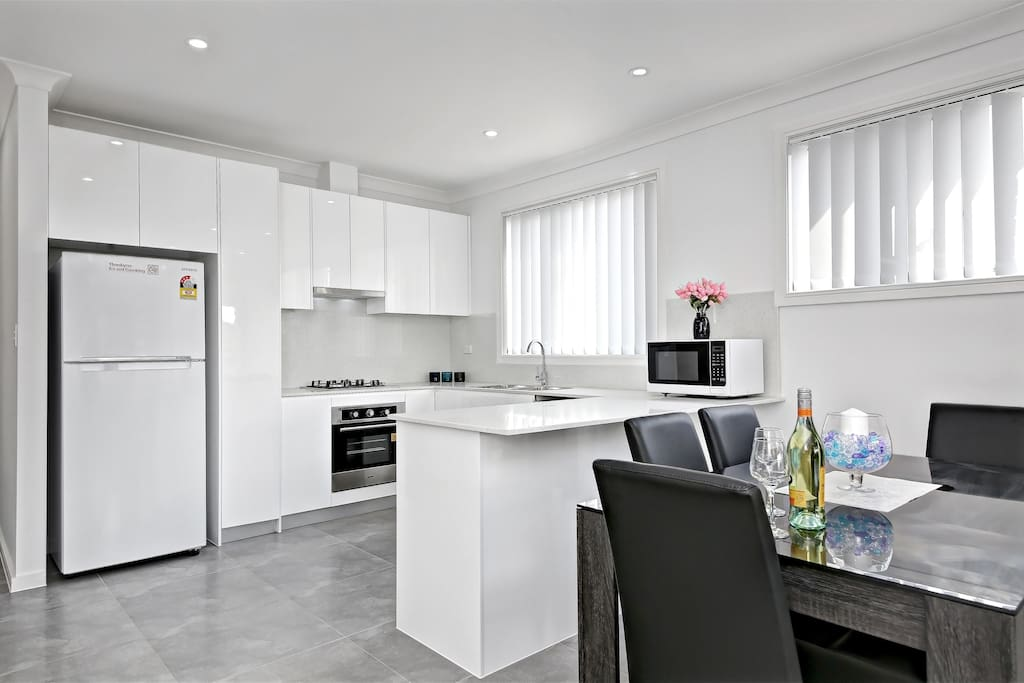 Lovely and modern, fully equipped kitchen with dining area
