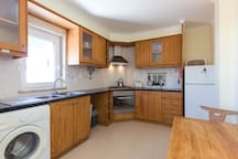 Large kitchen with sunset balcony ,All rooms at the Lodge may use this Kitchen