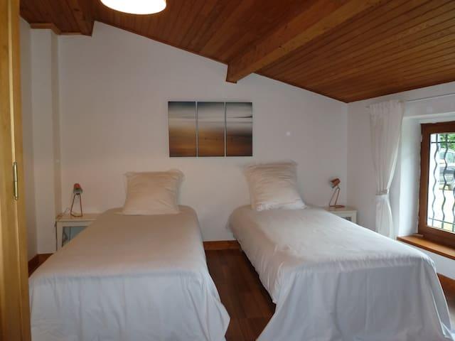 Chambre petits lits séparés
