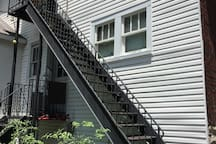 Twenty fire-escape-style stairs bring you to the front door. It feels like a new step is added everyday. But trust me, it's worth the climb. Parking is in back, also. Free parking on street, too.