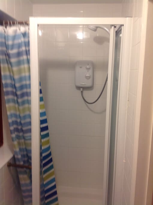 Shower room and toilet with wash basin.