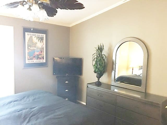 Bedroom #3 Queen Bed with Black Out Curtains/ Ceiling Fan & Amazon Fire TV Stick 4K with all-new Alexa Voice Remote, streaming media player.