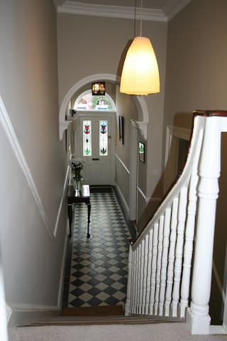 Hallway with Victorian arch and stained glass door