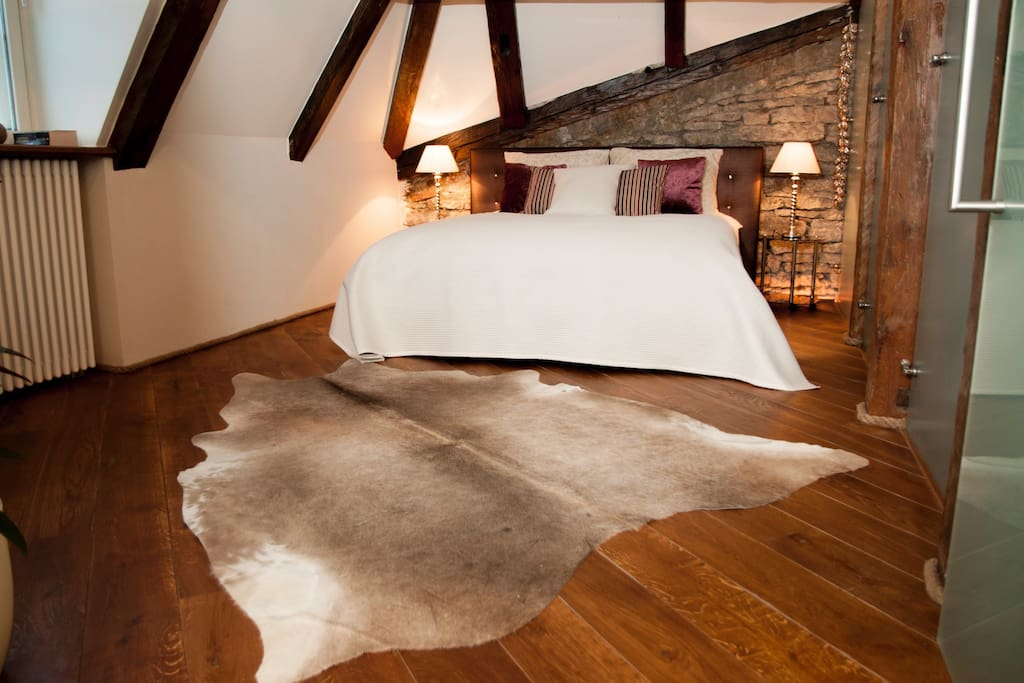 Master Bedroom - So, when night falls and the wonderful kingsize bed with wonderful, deep sleep mattress awaits, you will sleep under the tall high pitched roof with its many exposed beams