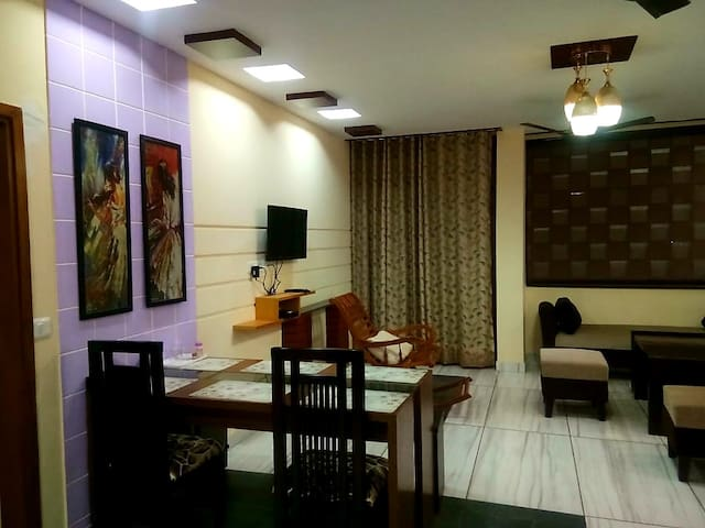 Main Private hall/Lobby with Sofa Cum Bed, Dinning Table, relaxing Chair and LED with Satellite channels
