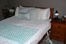 Queen bed, extra blankets, pillows etc. available.