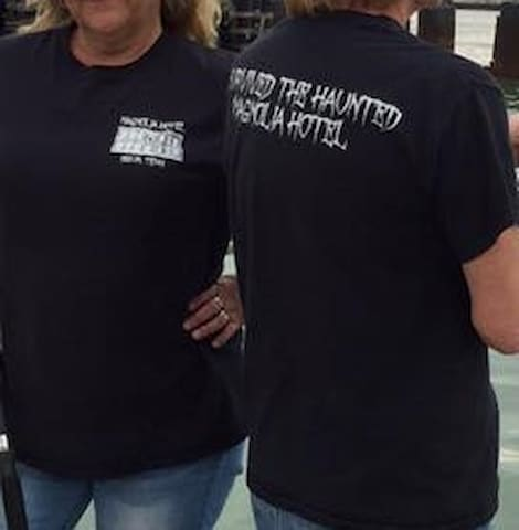 "Before your stay you can arrange to purchase our ""Magnolia Hotel"" T-shirts. On the back of the crew neck t-shirts it says ""I survived the Haunted Magnolia Hotel"" for $22. They come in sizes S-XXXL. Just let us know before noon on the day you arrive!"