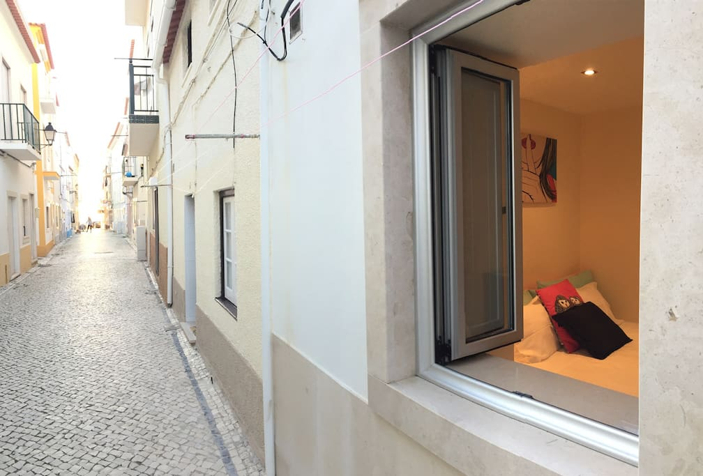 Bedroom window to one of the most beautiful streets of Nazaré