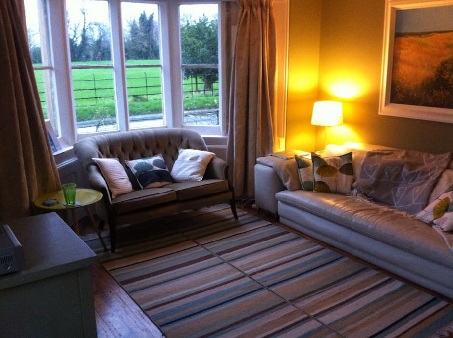 Living room: views onto the field in front of the house.