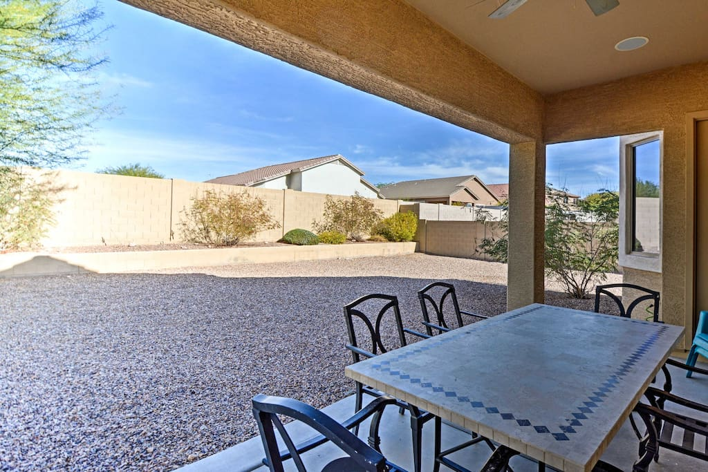 Featuring a spacious yard with a covered patio, this vacation rental house promises a relaxing Gold Canyon retreat!