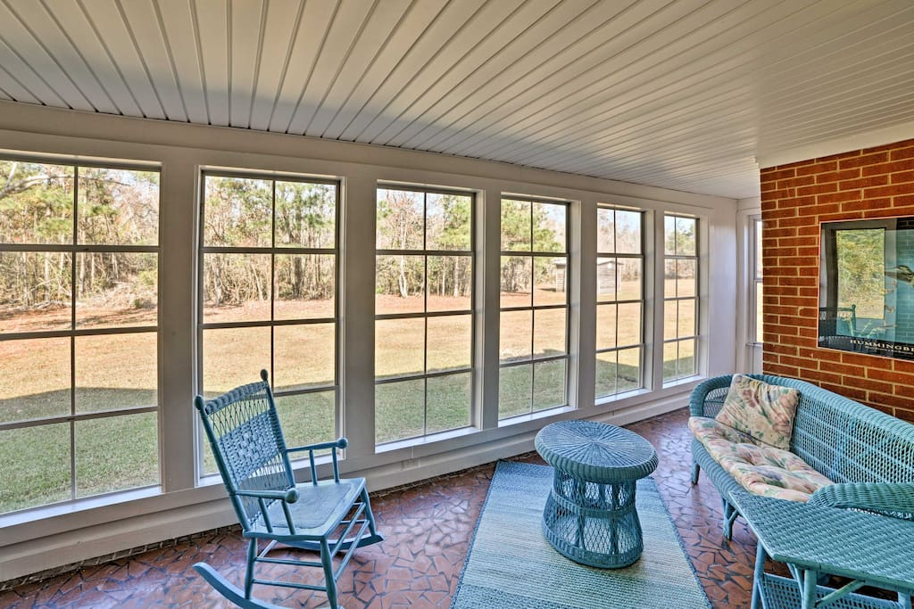 Sit back and admire the property's 35 private acres from the sunroom.