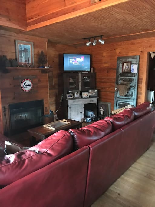 Den with large couch and living area