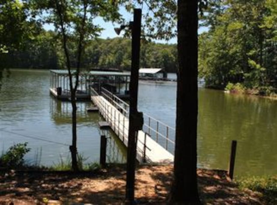 Dock for boating, kayaking, swimming, and fishing on a quiet cove.