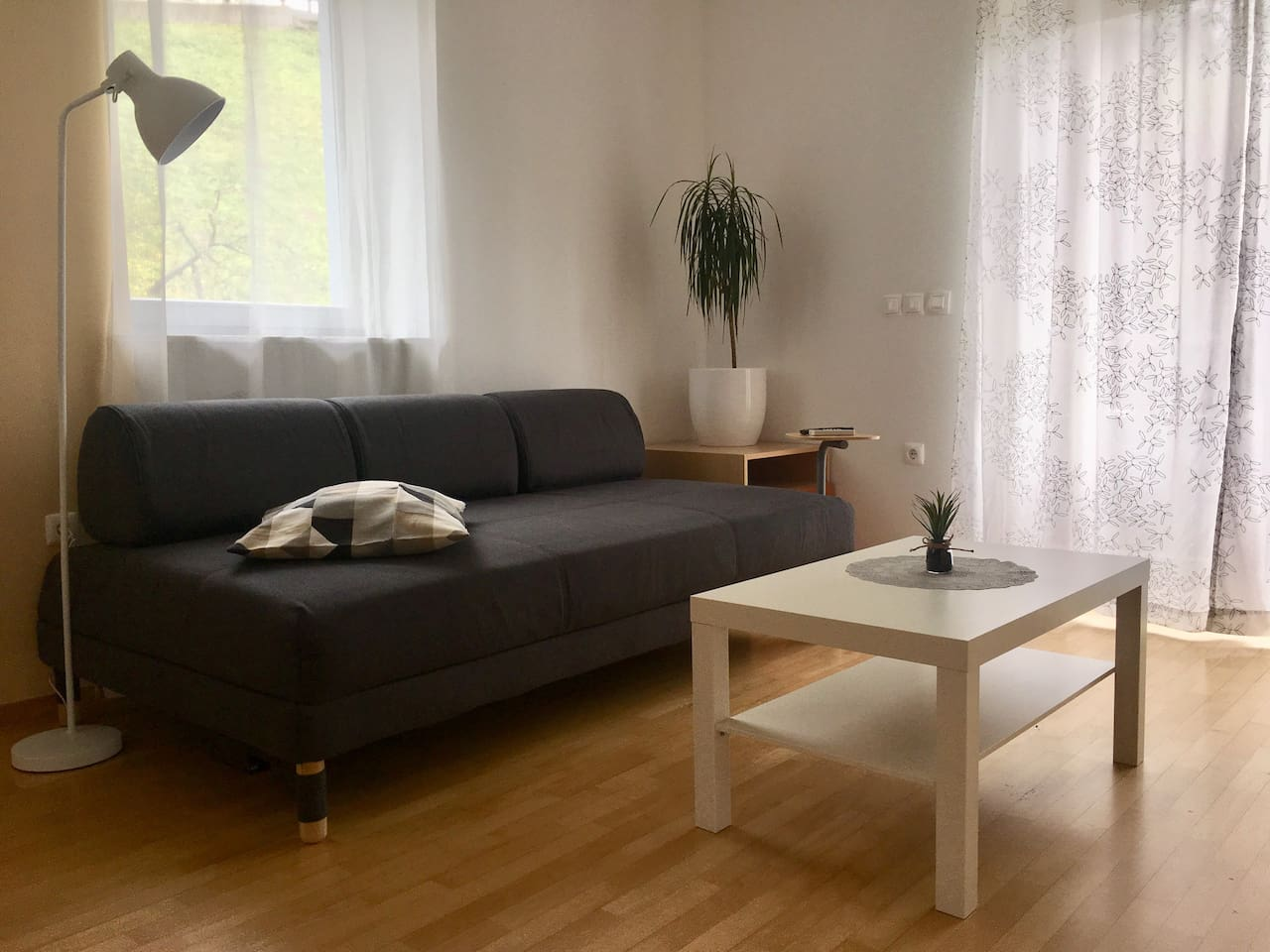 Spacious and cozy living area to relax after a day of exploring the sights :)