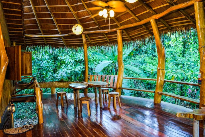 Spacious and breezy balcony surrounded by jungle
