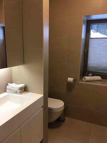 First floor children's bathroom with 1 sink, 1 bathtub including shower and toilet. Not en-suite and no extra shower