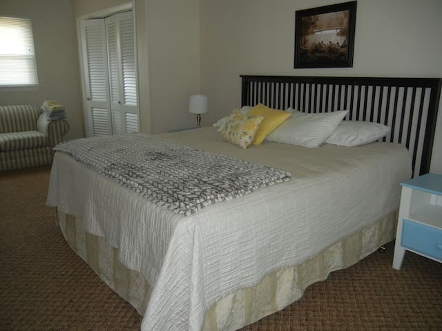 Nice relaxing master bedroom with king size bed and water view.