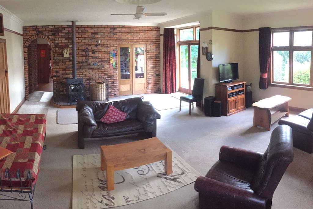 Spacious lounge room with log burner and comfortable daybed to chill out on