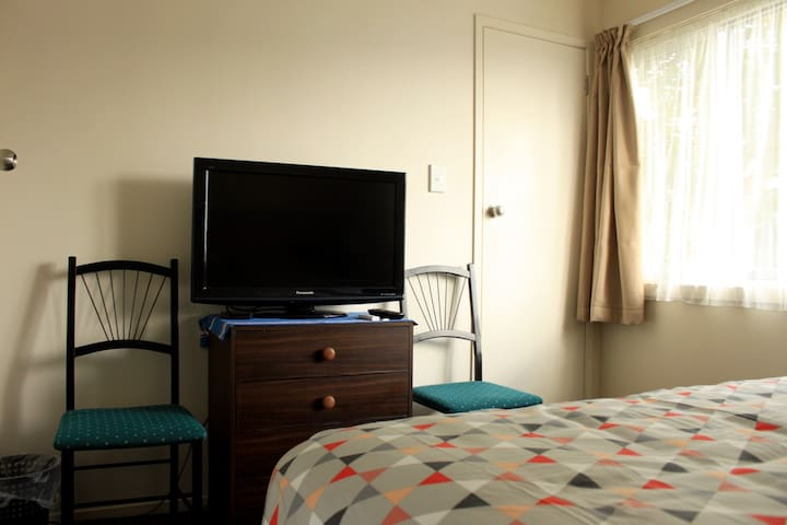 Guest bedroom - Flat screen TV with Apple TV.