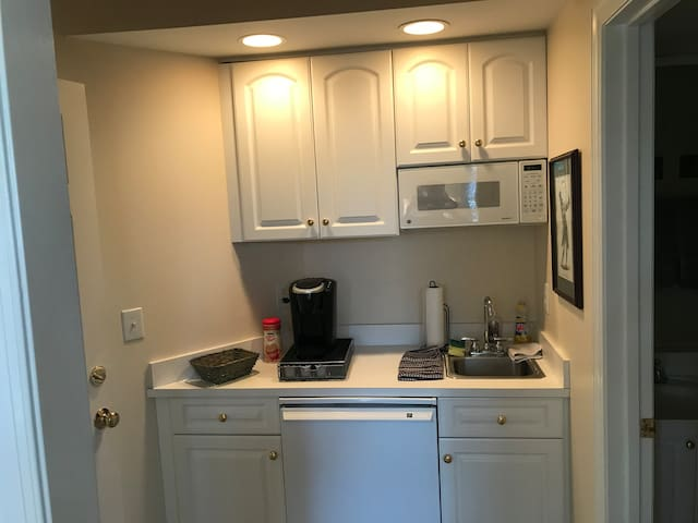 Mini Kitchenette. Keurig, sink, microwave and cupboards/dishes