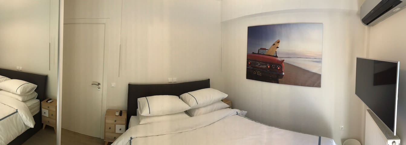 Bedroom with ensuite bathroom and garden and terrace access