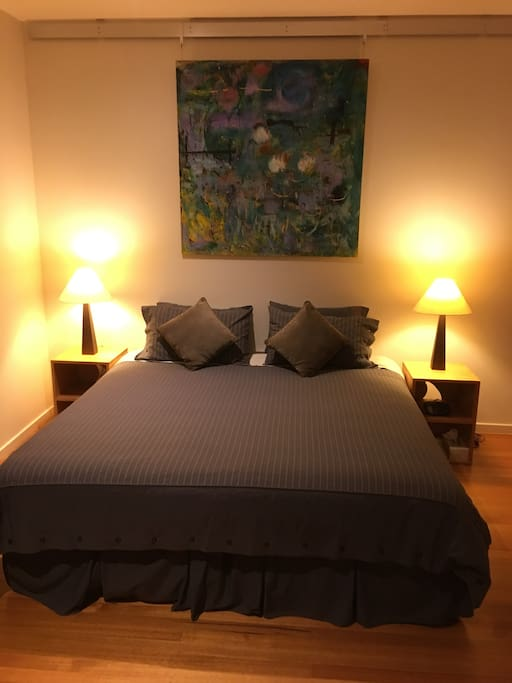 King size bed in a beautiful large room with couch  smart TV, Bluetooth speakers for your music.