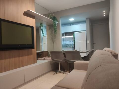 Charmoso designer apartamento super bem localizado