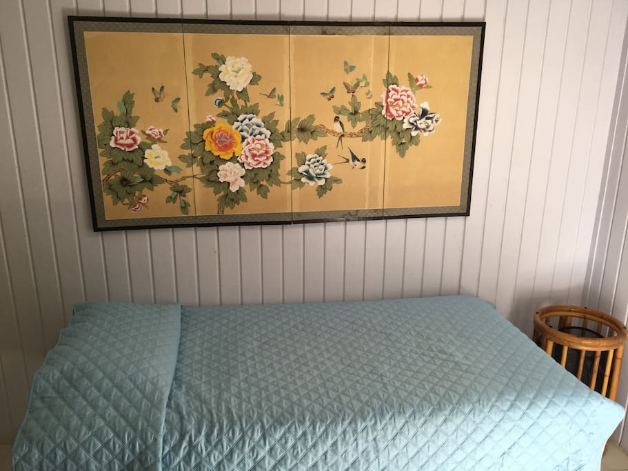 Regular twin bed in same room as king bed.