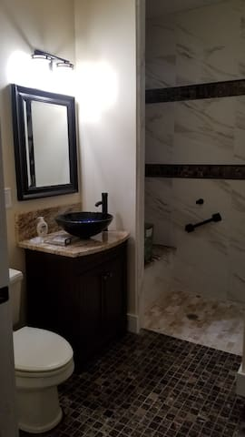Private Bathroom. Handicap accessible, with seat and handrails.