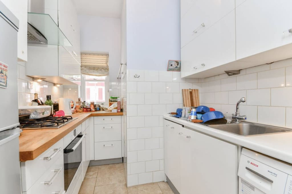 spacious kitchen with washer and dryer, guest use is welcome (provided you clean up after yourself)