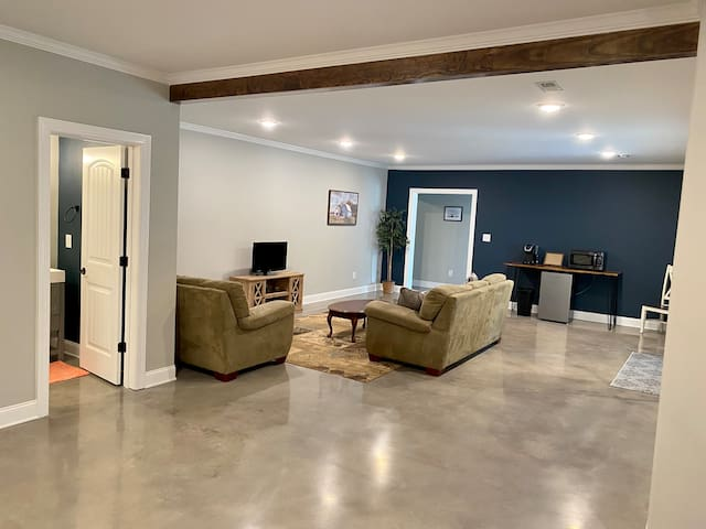 Main living area with comfy couches and TV