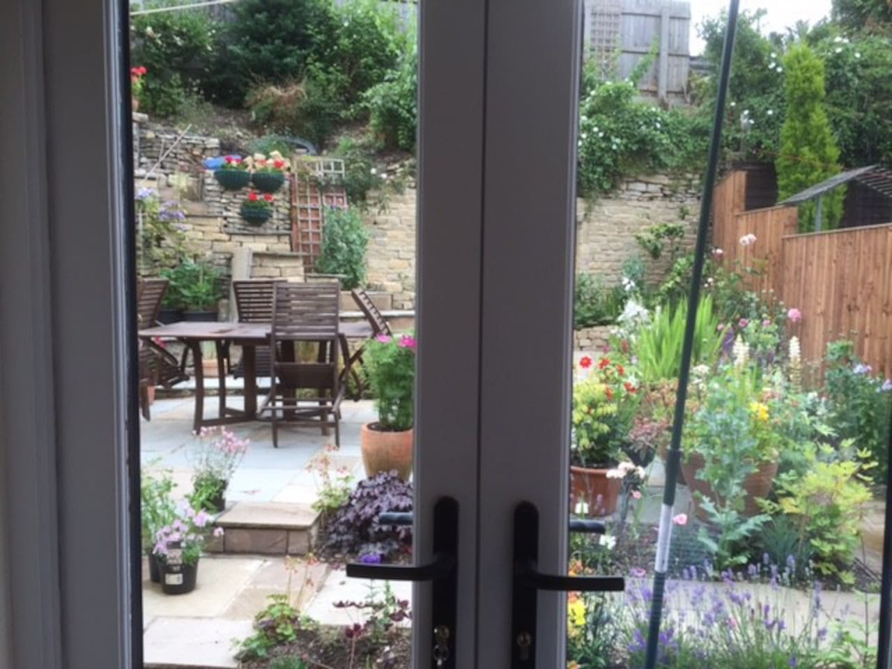 French windows into courtyard garden in which guests are welcome.