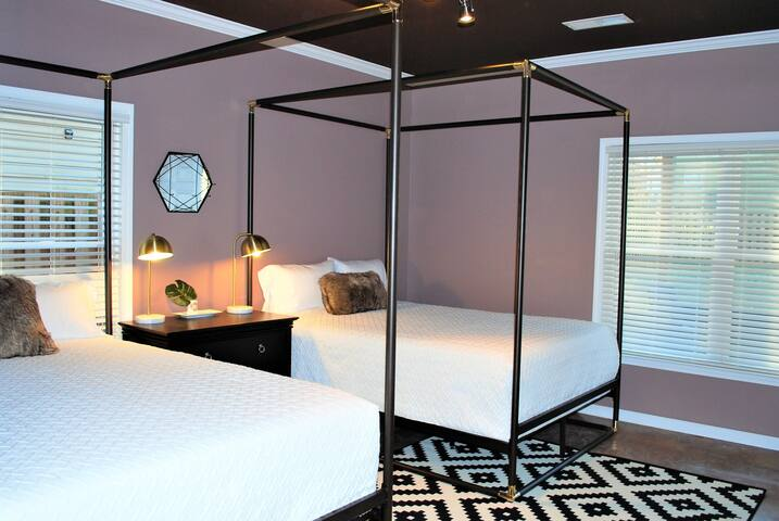 First level bedroom with 2 queen beds