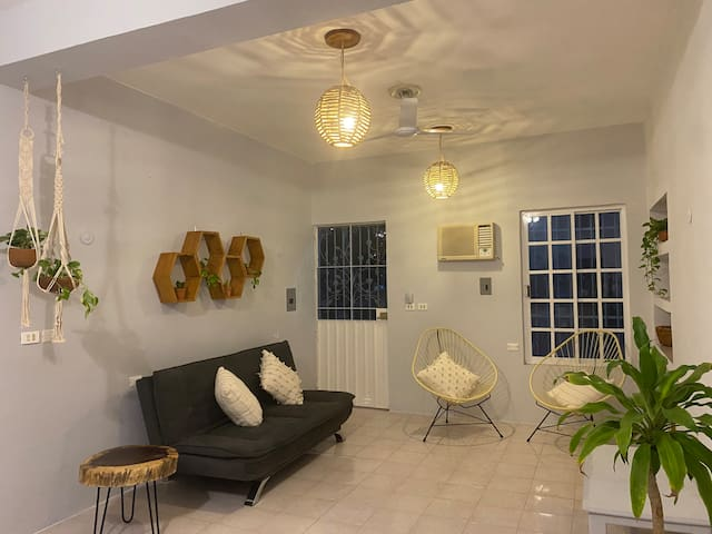 Rosewood Downtown House is the perfect place to get away. Close to downtown and just a couple blocks from the seashore. It has hot water, Wifi and AC.