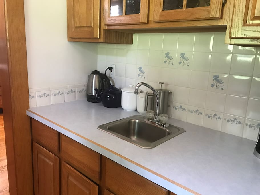 """There is a """"Butlers Pantry"""" between the kitchen and the dinning room.  We keep this stocked with lots of teas and Keurig coffee pots for our guests to use as they please."""