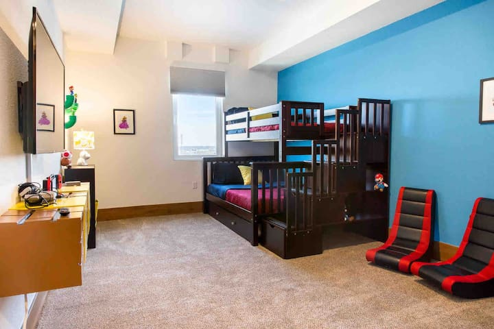 Large bedroom/game room with a twin over full bunk and twin trundle
