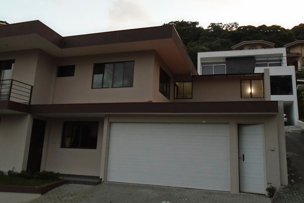 Front view of Condominium located in high end private residential Montaña Luna in beautiful Rio Oro de Santa Ana, surrounded by mountains and lush green nature.