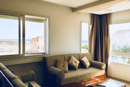 Appartement neuf vue mer à 100m de la plage