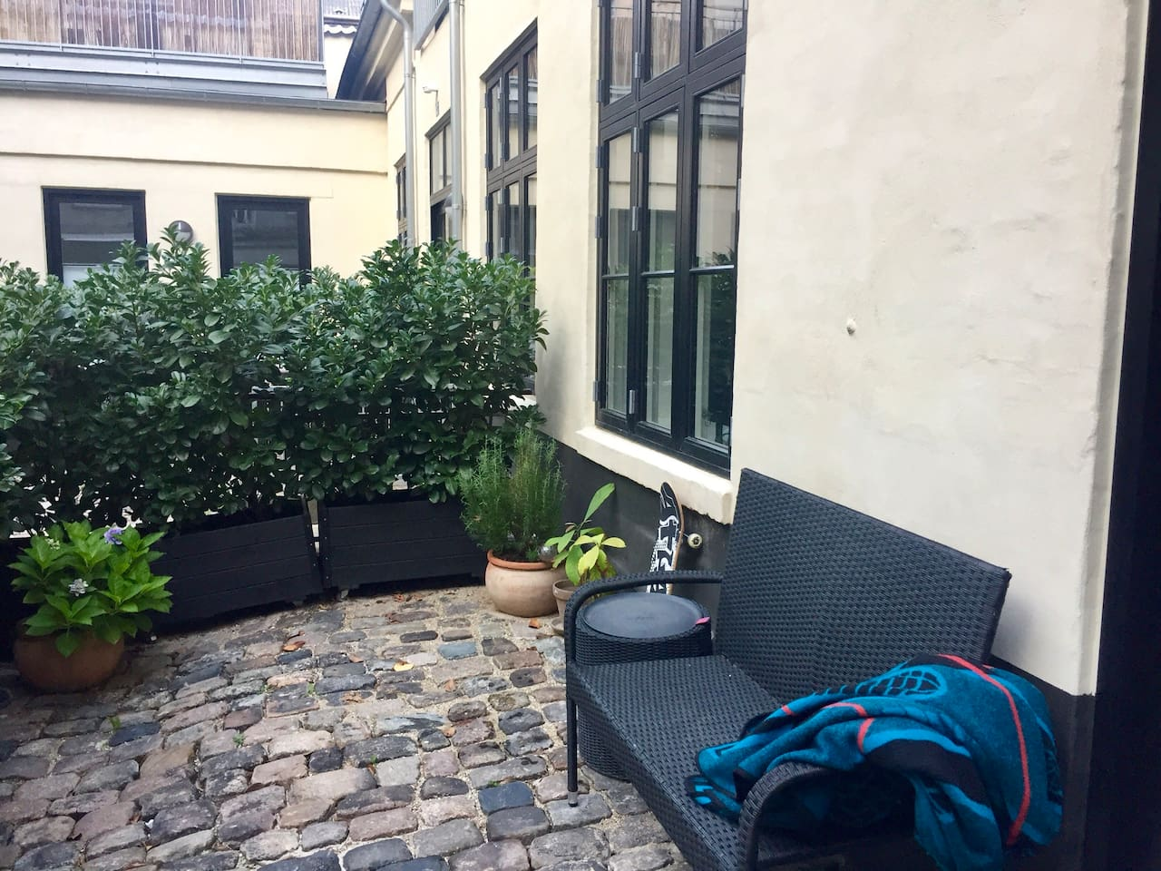 Drawn back from busy Sankt Hans Torv the apartment is located at the ground floor of a small town house  with a quiet inner yard. The picture shows the private outdoor area in the front of the apartment.