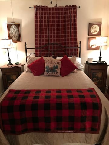 Queen size bed with comfort topper. Come sink in after a long day of shopping or hiking here in the pineywoods