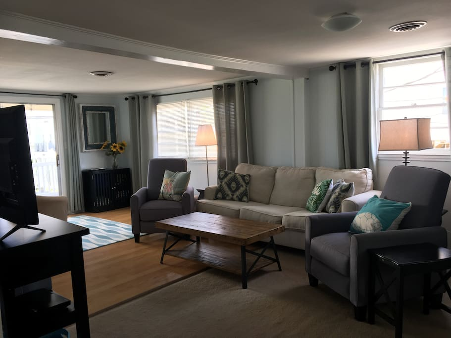 The cozy living room is a great space to relax after a day at the beach or to walk  back for a quick rest while the kids take a nap.