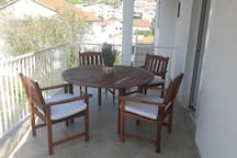 Table and chairs front of common kitchen
