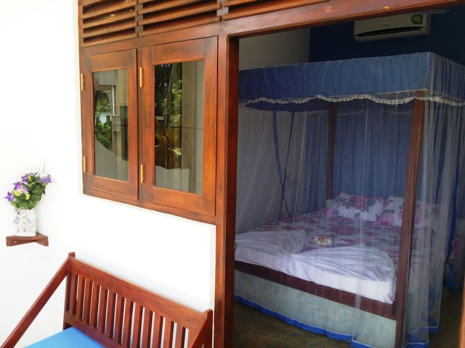 Comfortable double bedroom with A/C and Fan.