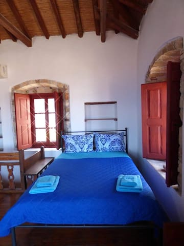 The first double bed on the upper floor.