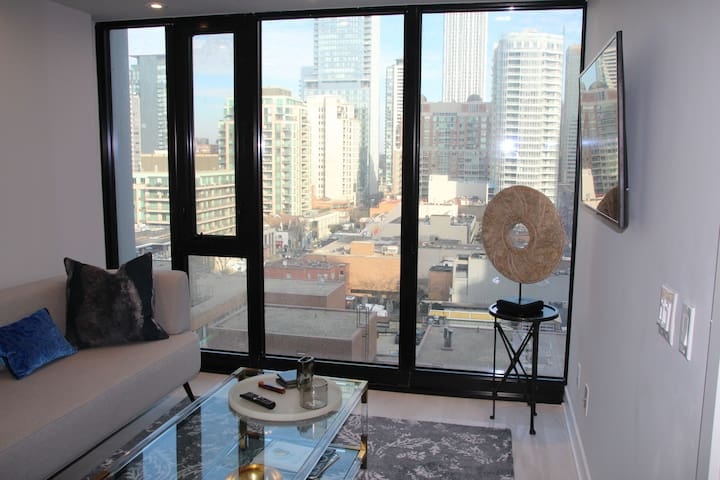 Great view-East facing overlooking Yorkville from Cumberland Street.  TV in the living room with free Wifi.